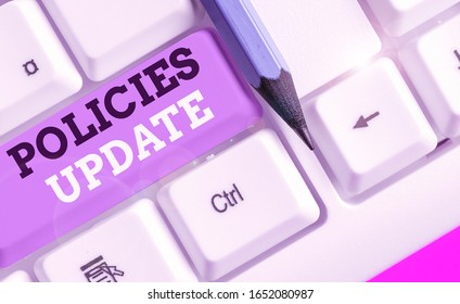 Writing note showing Policies Update. Business photo showcasing act of adding new information or guidelines formulated.
