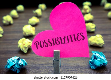 Writing note showing Possibilities. Business photo showcasing Things that may happen or be the case State of being possible Paper objects thoughts hart crumpled papers mistakes several tries.