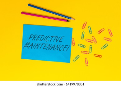 Writing note showing Predictive Maintenance. Business photo showcasing Predict when Equipment Failure condition might occur Blank paper sheet message reminder pencils clips colored background.