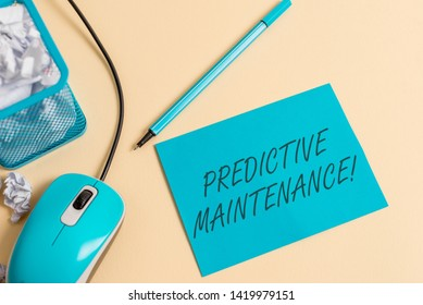 Writing note showing Predictive Maintenance. Business photo showcasing Predict when Equipment Failure condition might occur crumpled paper trash in bin placed next to modern gadget and stationary.