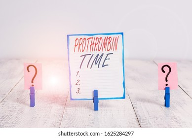 Writing note showing Prothrombin Time. Business photo showcasing evaluate your ability to appropriately form blood clots Crumbling sheet with paper clips placed on the wooden table.