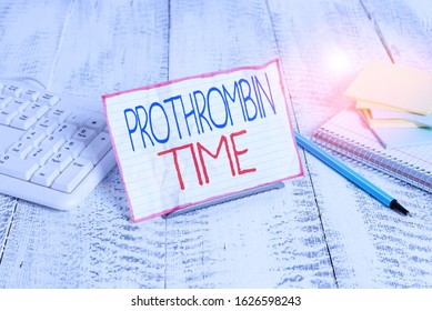 Writing note showing Prothrombin Time. Business photo showcasing evaluate your ability to appropriately form blood clots Notepaper on wire in between computer keyboard and sheets.