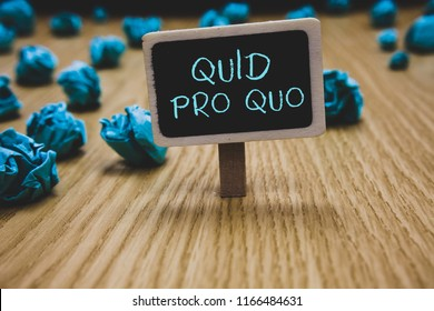 Writing note showing Quid Pro Quo. Business photo showcasing A favor or advantage granted or expected in return of something Blackboard crumpled papers several tries not satisfied wooden floor.