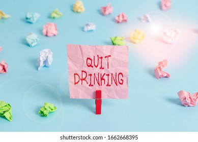 Writing note showing Quit Drinking. Business photo showcasing involves staying away from consuming alcoholic beverages Colored crumpled rectangle shaped reminder paper light blue background.