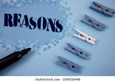 Writing note showing  Reasons. Business photo showcasing Causes Explanations Justifications for an action or event Motivation written on Painted background wooden Clips and Marker next to it.