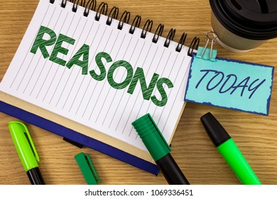 Writing note showing  Reasons. Business photo showcasing Causes Explanations Justifications for an action or event Motivation written on Noteoad on wooden background Today Cup Pen Marker next to it
