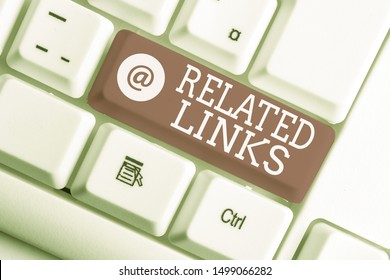 Writing note showing Related Links. Business photo showcasing Website inside a Webpage Cross reference Hotlinks Hyperlinks White pc keyboard with note paper above the white background.