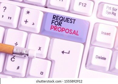 Writing note showing Request For Proposal. Business photo showcasing document contains bidding process by agency or company White pc keyboard with note paper above the white background.