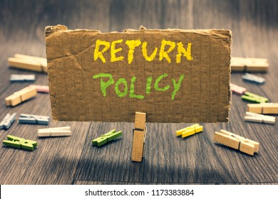 Writing note showing Return Policy. Business photo showcasing Tax Reimbursement Retail Terms and Conditions on Purchase Clothespin holding paperboard important communicating message ideas.