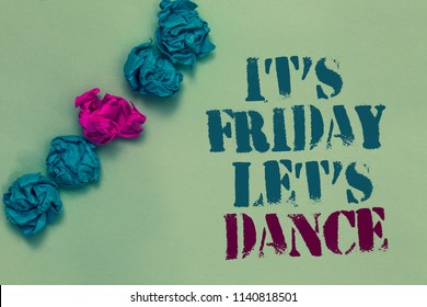 Writing note showing It s is Friday Let s is Dance. Business photo showcasing Celebrate starting the weekend Go party Disco Music Drawn blue and red words teal color paper lump mid pink on blue floor.