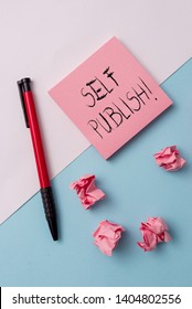 Writing note showing Self Publish. Business photo showcasing writer publish piece of ones work independently at own expense Note papers and stationary placed sideways on top of softhued backdrop.