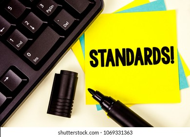 Writing note showing  Standards Motivational Call. Business photo showcasing Quality Controls Regulations Guidelines written on Yellow Sticky note paper on plain background Keyboard Marker