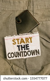 Writing note showing Start The Countdown. Business photo showcasing Sequence of Backward Counting to Set the Timer Small wallet inside trouser front pocket near notation paper.