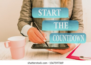 Writing note showing Start The Countdown. Business photo showcasing Sequence of Backward Counting to Set the Timer Business concept with mobile phone in the hand.