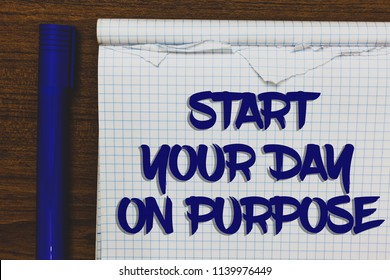 Writing note showing Start Your Day On Purpose. Business photo showcasing Have clean ideas of what you are going to do Written white notepad on grey wooden background beside blue marker.