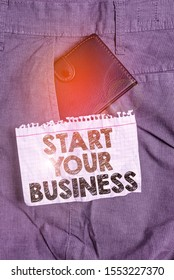 Writing note showing Start Your Business. Business photo showcasing going into a New Venture Create New Product Services Small wallet inside trouser front pocket near notation paper.