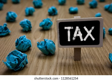 Writing note showing Tax. Business photo showcasing Compulsory payment of taxes by people to government increase revenue Cyan paper imagination idea crumpled papers mistakes several tries.