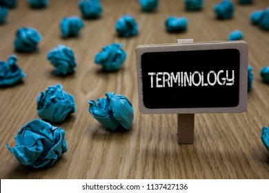 Writing note showing Terminology. Business photo showcasing Collection of terms used by different profession study industry Cyan paper imagination idea crumpled papers mistakes several tries.