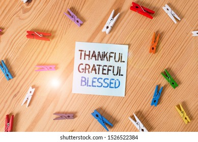 Writing note showing Thankful Grateful Blessed. Business photo showcasing Appreciation gratitude good mood attitude Colored clothespin papers empty reminder wooden floor background office.