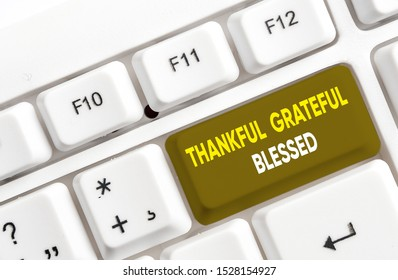 Writing note showing Thankful Grateful Blessed. Business photo showcasing Appreciation gratitude good mood attitude White pc keyboard with note paper above the white background.