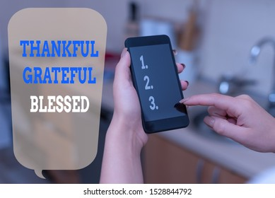 Writing note showing Thankful Grateful Blessed. Business photo showcasing Appreciation gratitude good mood attitude woman using smartphone and technological devices inside the home.