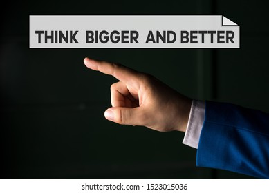 Writing note showing Think Bigger And Better. Business photo showcasing no Limits be Open minded Positivity Big Picture Isolated hand pointing with finger. Business concept pointing finger.