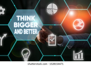 Writing note showing Think Bigger And Better. Business photo showcasing no Limits be Open minded Positivity Big Picture Male human wear formal suit presenting using smart device.