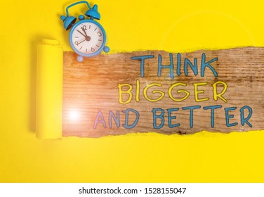 Writing note showing Think Bigger And Better. Business photo showcasing no Limits be Open minded Positivity Big Picture.