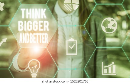Writing note showing Think Bigger And Better. Business photo showcasing no Limits be Open minded Positivity Big Picture Female human wear formal work suit presenting smart device.