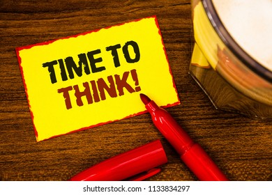 Writing note showing  Time To Think Motivational Call. Business photo showcasing Thinking Planning Ideas Answering Questions Words yellow paper note red border open marker cap coffee glass desk.