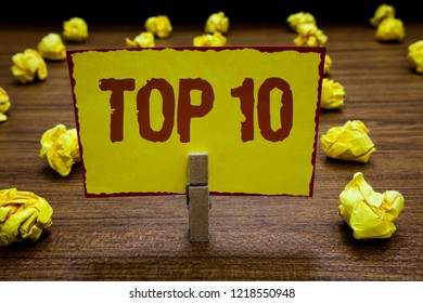Writing note showing Top 10. Business photo showcasing List of most demanding Trending songs movies shows online in order Clothespin holding yellow paper note crumpled papers several tries.