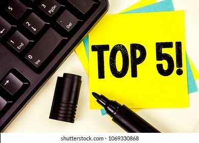 Writing note showing  Top 5 Motivational Call. Business photo showcasing The best ones Winners Most Popular Bestsellers written on Yellow Sticky note paper on plain background Keyboard Marker