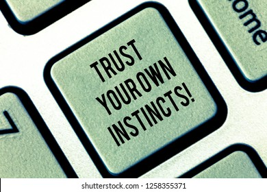 Writing note showing Trust Your Own Instincts. Business photo showcasing Intuitive follow demonstratingal feelings confidence Keyboard key Intention to create computer message pressing keypad idea.