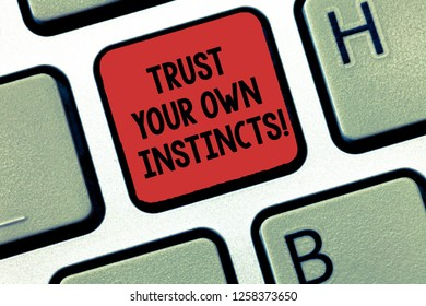 Writing note showing Trust Your Own Instincts. Business photo showcasing Intuitive follow demonstratingal feelings confidence Keyboard Intention to create computer message keypad idea.