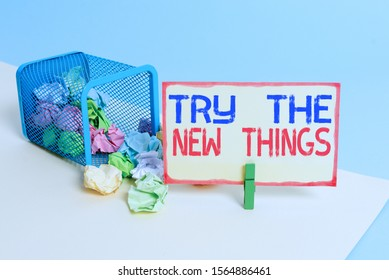 Writing note showing Try The New Things. Business photo showcasing Breaks up Life Routine Learn some Innovative Skills Trash bin crumpled paper clothespin reminder office supplies.