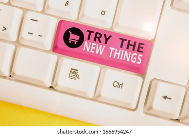 Writing note showing Try The New Things. Business photo showcasing Breaks up Life Routine Learn some Innovative Skills White pc keyboard with note paper above the white background.