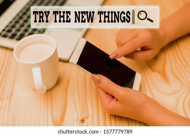 Writing note showing Try The New Things. Business photo showcasing Breaks up Life Routine Learn some Innovative Skills woman with laptop smartphone and office supplies technology.