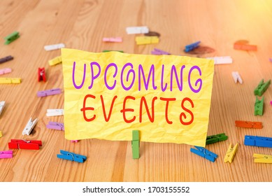 Writing note showing Upcoming Events. Business photo showcasing the approaching planned public or social occasions Colored clothespin papers empty reminder wooden floor background office.