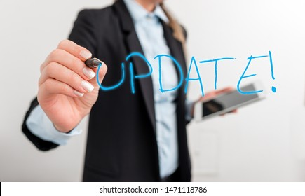 Writing note showing UPDATE. Business photo showcasing make something more modern or up to date like software program Digital business in black suite concept with business woman.