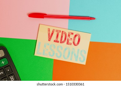Writing note showing Video Lessons. Business photo showcasing Online Education material for a topic Viewing and learning Office appliance square desk study supplies paper sticker.