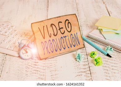 Writing note showing Video Production. Business photo showcasing process of converting an idea into a video Filmaking Notepaper on wire in between computer keyboard and sheets.