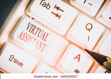 Writing note showing Virtual Assistant. Business photo showcasing demonstrating who provides various services to entrepreneurs.