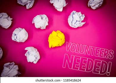 Writing note showing  Volunteers Needed Motivational Call. Business photo showcasing Social Community Charity Volunteerism Pink ground white paper lumps shadow yellow lob outline letters.