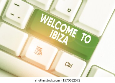 Writing note showing Welcome To Ibiza. Business photo showcasing Warm greetings from one of Balearic Islands of Spain White pc keyboard with note paper above the white background.