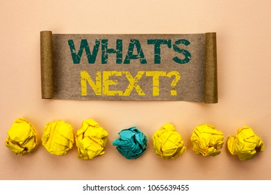 Writing note showing  What s Next Question. Business photo showcasing Asking Imagination Choice Solution Next Questionaire written on Cardboard Paper on the plain background Crumpled Paper Balls