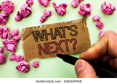Writing note showing  What s Next Question. Business photo showcasing Asking Imagination Choice Solution Next Questionaire written by Man Holding Marker on Tear Cardboard Piece plain background.