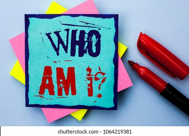 Writing note showing  Who Am I Question. Business photo showcasing Question Asked Identity Thinking Doubt Psycology Mystery written on Sticky Note Paper on the Plain background Marker next to it.