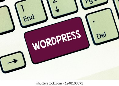 Writing note showing Wordpress. Business photo showcasing free source publishing software that can installed web server Keyboard Intention to create computer message keypad idea.