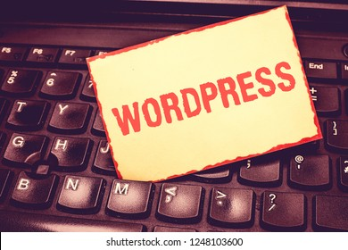 Writing note showing Wordpress. Business photo showcasing free source publishing software that can installed web server Blank Bordered Notepad Reminding Inserted Between Keys of Laptop.