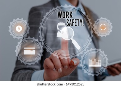Writing note showing Work Safety. Business photo showcasing policies and procedures in place to ensure health of employees Woman wear formal work suit presenting presentation using smart device.